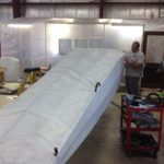 New Ceconite being installed on fuselage.
