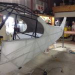 Fuselage fabric ironed and tightened.